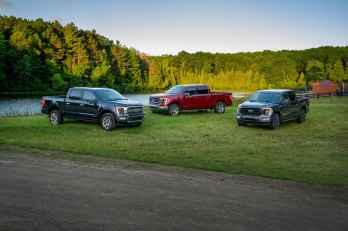 (left to right) All-new F-150 Limited in Smoked Quartz Tinted Clearcoat, F-150 Lariat in Rapid Red Metallic Tinted Clearcoat and F-150 XLT Sport Appearance Package in Carbonized Gray.
