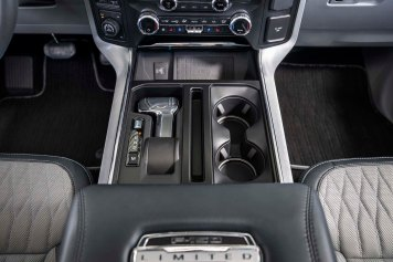 The all-new F-150 features and an available stowable shifter that easily folds into the center console of the all-new F-150 with the push of a button and allows full access to the large Interior Work Surface when in park.