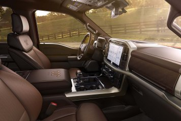 The cabin is completely redesigned with more comfort, technology and functionality for truck customers along with more premium materials, more color choices and more storage. Shown here is the interior of the all-new F-150 Limited. Shown here is the interior of the all-new F-150 King Ranch.