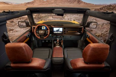 2021 Bronco two-door features class-leading open-air design roof and instrument panel inspired by the first-generation Bronco, with intuitive, clearly visible gauges and controls in this prototype version (not representative of production model). Prototype not representative of production model. (Static display on private property with aftermarket accessories not available for sale.)