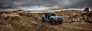 Pre-production 2021 Bronco four-door Badlands series with available Sasquatch™ off-road package in Cactus Gray with the doors, top and rear quarter windows removed.