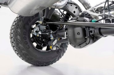 Closeup of the 2021 Bronco solid rear axle linkage and the M220 Dana 44 differential with electronic locking.