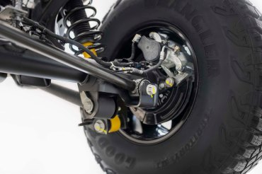Closeup of the 2021 Bronco solid rear axle linkage, disc brake and electronic parking brake.