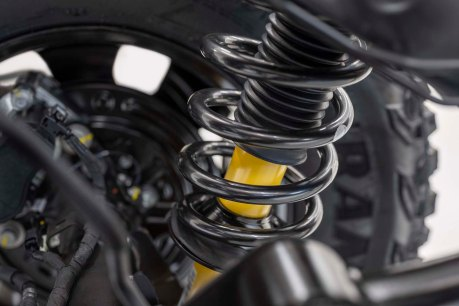 Closeup of a rear coil-over spring and available Bilstein long-travel position-sensitive shock absorber.