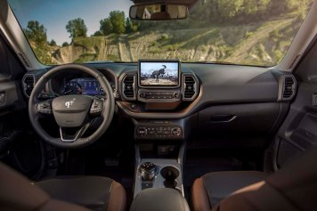 The all-new Bronco Sport small SUV comes standard with SYNC® 3 and an 8-inch touchscreen, which includes compatibility with Apple CarPlay™ and Android Auto™. (Pre-production model pictured.)