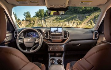 The all-new Bronco Sport small SUV comes standard with an 8-inch touchscreen, which gives the driver a close look at the trail ahead courtesy of an available class-exclusive front off-road camera. (Pre-production model pictured.)