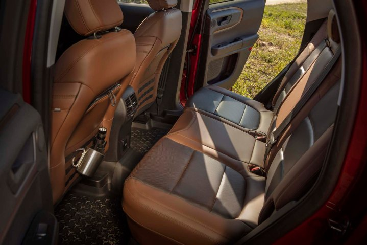 Some human-centered design features in the all-new Bronco Sport include available class-exclusive zipper pockets with MOLLE strap system on the seatbacks to help users safely and easily transport gear. (Pre-production model pictured.)