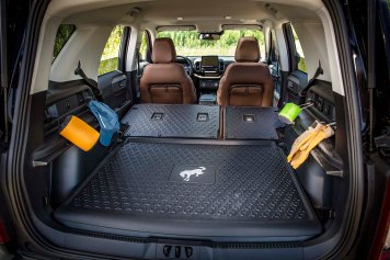 The all-new Bronco Sport is available with washable rubber flooring in the cargo area and on the second-row seatbacks for easy cleanups, and tie-down carabiner hooks in the cargo area. (Pre-production model pictured.)